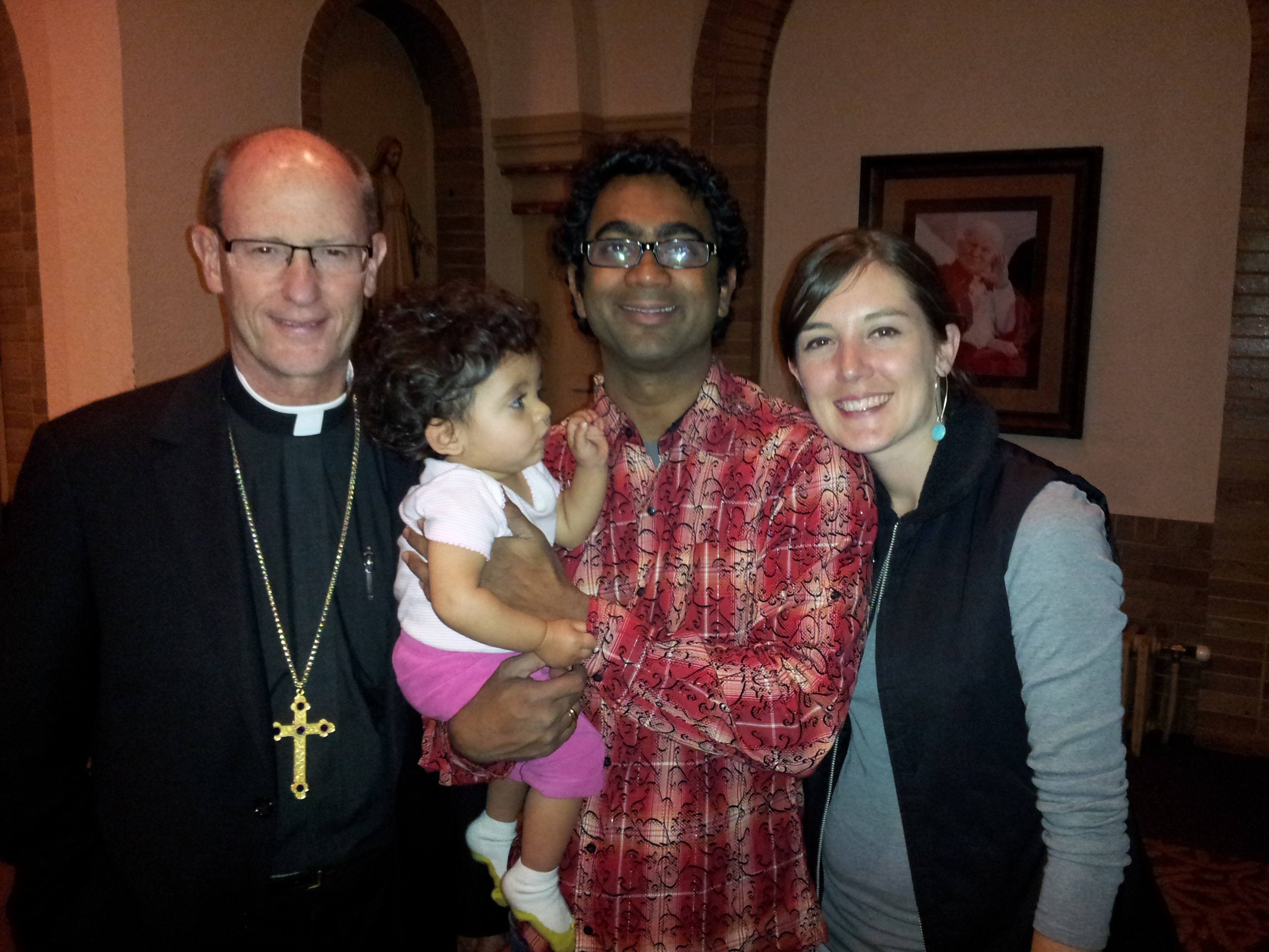 Bishop Conley with Anand's Family